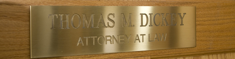 gold door plaque of Thomas M. Dickey law offices